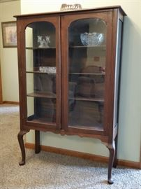 Antique Queen Anne style cherry curio cabinet