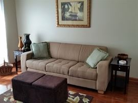 The sofa is about seven feet long.  The two end tables match another one in an earlier photo.  The ottoman opens for storage.