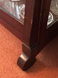 Detail of scroll feet of china cabinet