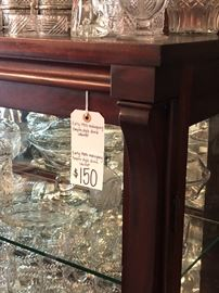 Price tag of china cabinet and top corner detail