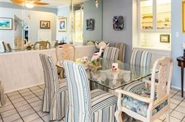 Beautiful glass top dining table and 6 blue striped chairs, arm chairs will be sold separately