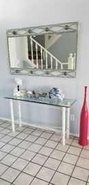 glass entry table, coral specimens, metal and glass mirror