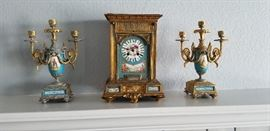 Rare  find Porcelain and heavy cast gilt clock and candelabra pair