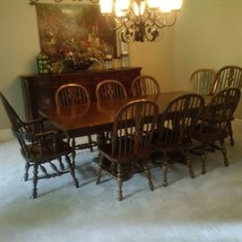FIRM- $2800.00 - The furniture details are, Table 42 x 66 inches with 2 – 18 inch table leaves for a total table length of 102 inches. There are 8 side chairs and 2 captain chairs, for a total of 10 chairs. The set is an Ethan Allen – Royal Charter Oak, and I believe the style is Windsor. Purchased around 1967 for an approximate cost of $3800. Online chairs list $400-600 each