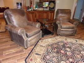Two matching Leather Motion Craft by Sherrill three way low leg recliner with nail head trim  fully reclining chairs OUR PRICE $300.00 EACH, beautiful area rug and one of two Seven Seas by Hooker end tables with drawer $75.00 each