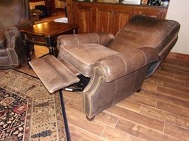 Two matching Leather Motion Craft by Sherrill, three way low leg recliner with nail head trim  fully reclining chairs, beautiful area rug and one of two Seven Seas by Hooker end tables with drawer