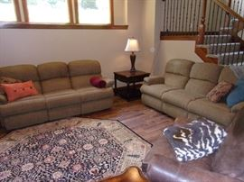 Two matching Flexsteel dual wall hugger reclining sofas/couch quality excellent condition and clean! #350.00 each Beautiful area rug and one of two Seven Seas by Hooker end tables with drawer!