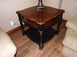 One of two Seven Seas by Hooker end tables with drawer
