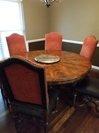 Round dining table and upholstered chairs.