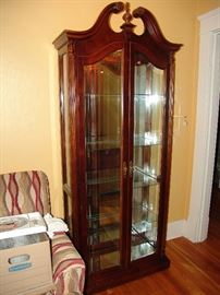 Mahogany curio cabinet with light and beveled glass