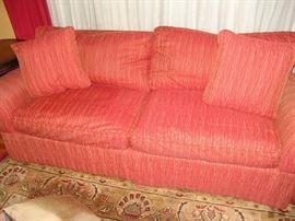 Upholstered cushion sofa