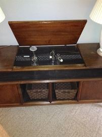 Repurposed Console Stereo into Bar and/or TV Entertainment Center.  Baskets included.