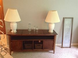 Repurposed Console Stereo into Bar and/or TV Entertainment Center.  Baskets included.  Several Lamps as well.
