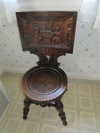 Antique victorian hand-carved pub chair with tavern scene