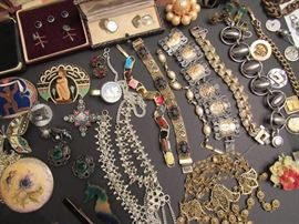 Costume and antique jewelry including brooches, cuff links, tie clips, bracelets, necklaces, clip on earrings, and more (just a sample)