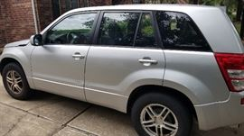 2007 Suzuki Grand Vitara 4X4. 99k miles. VIN: JS3TD941X74202082, Newly detailed. Fair condition. Disclosures: has an outstanding factory recall: the OCS sensor mat installed in the front passenger seat may fail due to repeated flexing of the mat from use of the seat. OCS is Occupant Classification System. The air bag light is on, as well as the tire pressure sensor light. The back seat of the car needs significant upholstery repair.A few dings.