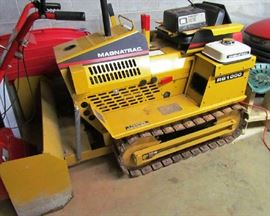 Struck Magnatrac RS 1000, with front blade attachment, plow and towing attachments