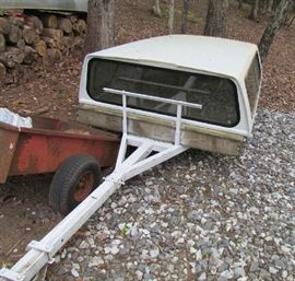 Trailer is separate, and can be used for boat or for hauling on flat platform.  Cover is from GMC pickup.