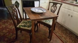 country breakfast table and ribbon-back Chippendale chairs