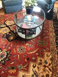 Room area size carpets in brilliant colors.  Glass top and iron, oval table (suitable for livingroom/family room.