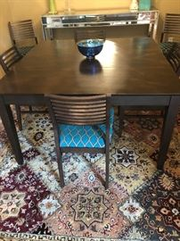 Square dining room table, fitting 8 chairs, which are available.  Perfect for a townhouse dining room.  All furniture is in immaculate condition!