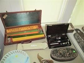 Vintage hand-painted and hand-carved Mahjong set and a vintage eye doctor's tool kit mixed in with beautiful art pieces