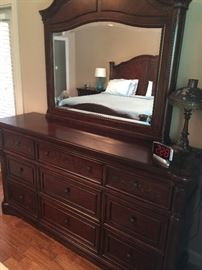 Selling a Bedroom Set consisting of the Dresser with Mirror as pictured, a King-sized bed with headboard and footboard (Temperpedic memory foam mattress sold separately - 10-years old but never removed from protective bag); 2 matching nightstands, Matching chest of draws. All items in excellent condition. Price of bedroom set without mattress: $2,000