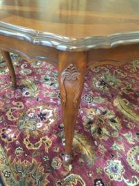 Pictured is one of the dining room table legs, showing the intricate detail. For sale is a beautiful Dining Room set consisting of a Dining Room Table with 2 leaves, a table pad, 6 side chairs (in separate picture) and a matching China Cabinet (in separate picture.) Everything is in wonderful condition, including the Lexington chairs.  Originally purchased at Macy's.  Price for the Dining Room set: $1,500.