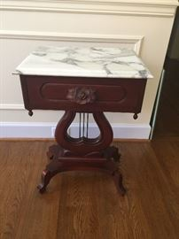 This is a marble topped lyre (harp) legged table. It is 75-100 years old and originally belonged to the owner's aunt.  A close-up of the table base is posted in a separate picture. Price: $150