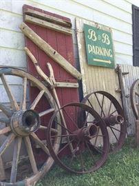 Antique farm wheels, bead board, barn wood remnants, wagon wheels