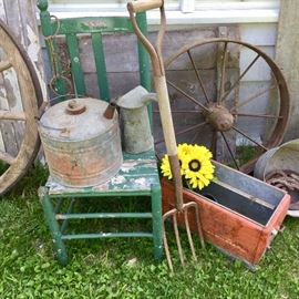 Vintage gas cans, vintage cooler, shabby chic chair and decor