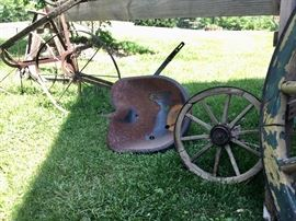 Antique tractor seats, wagon wheels, ploughs, and more!