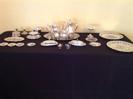 Silver tea set and serving pieces.