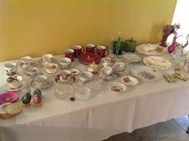 Vintage dishes and several porcelain tea sets.
