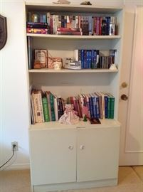 We have two bookshelves with storage below.