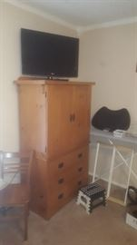 LG Television and chest of drawers