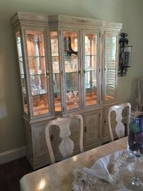 Beautiful blonde colored lighted hutch with glass shelves. The hutch matches the dining room table. It is part of the Dining Room Set that includes the lighted hutch, dining room table, 6 side chairs, and 2 arm chairs. Price for the whole set: $1,500