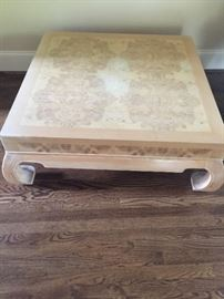 "Large square blonde color coffee table with curved feet. The 16"" tall table is similar in color to the dining room table. Price: $75."