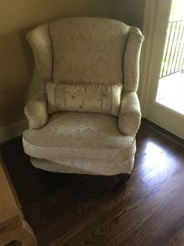 This large wingback chair is upholstered in a beautiful ivory colored material. The chair is in great condition. Price: $75