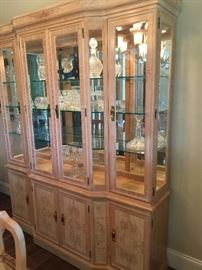 Beautiful blond color lighted hutch with glass shelves. One piece in the dining room set. Corinthians by Heritage. Price: $1,500 (includes dining room table, 6 side chairs, and 2 arm chairs)