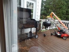 Grill, smaller grill, more ladders, lawn mower.