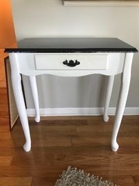 White table with black top