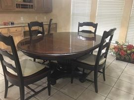 Table and 6 Chairs -- this has a glass top  that protects the wood  Hooker Brand