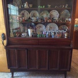 mid century danish modern china cabinet full of smalls