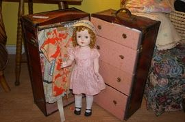 antique doll with truck loaded with clothes