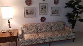 Interesting mid century sofa with leather top end tables, faux tree