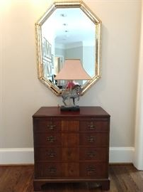 Vintage 4-Drawer banded mahogany chest, octagonal wall mirror, with Tang Dynasty bronze table lamp.