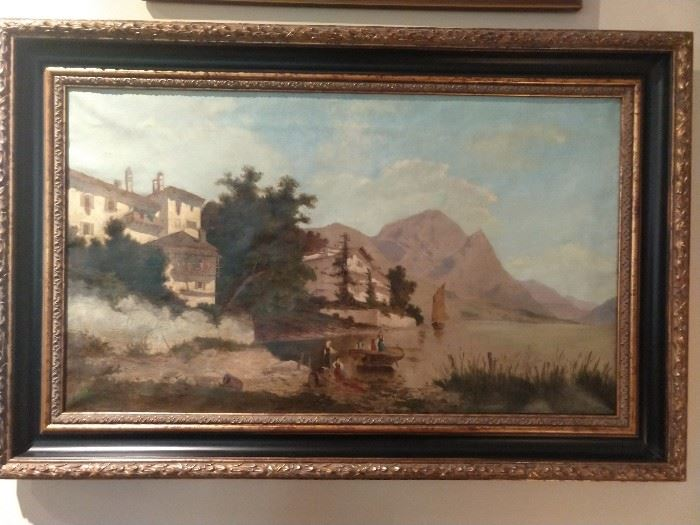 "Early 20th cent. oil on canvas depicting a serene mountain lake scene in the northern Italian alpine foothills, unsigned, measures 18"" h x 31"" w, overall size including frame 25""h x 37.5""w x 2.5""d."