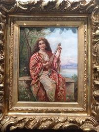 "Early-mid 20th cent. Orientalist oil on canvas depicting  beauty in the Ottoman dress playing a lute on a balcony. Artist signed, 14.25""h x 11.25""w overall dimensions including the frame, 22.5"" x 37.5"" x 2.5""d."