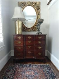 Vintage Kling 4-drawer mahogany chest, vintage metal putti, gold porcelain table lamp and gold gilt wood wall mirror, with beveled glass.